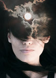 Double exposure portrait. Of young woman combined with photograph of sun among clouds Stock Images