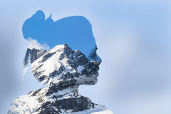 Double exposure portrait of young woman and mountain. Cover with snow Royalty Free Stock Photo