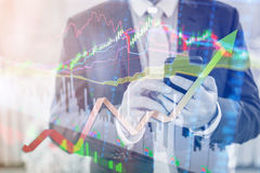 Double exposure of professional businessman connect internet smart phone and stock chart of business centre with international. World financial graph, Business stock image