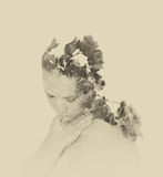Double exposure of red flowers in the beautiful young woman. black and white image, vintage effect stock images