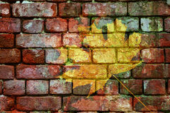 Double exposure rough old brick wall and yellow maple leaf Stock Photos