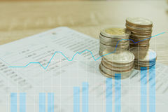 Double exposure of rows of coins on account book Royalty Free Stock Photo