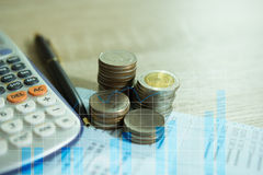 Double exposure of rows of coins on account book. Concept finance banking and save Royalty Free Stock Photos