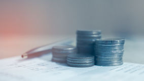 Double exposure of rows of coins on account book. Concept finance banking and save Royalty Free Stock Image
