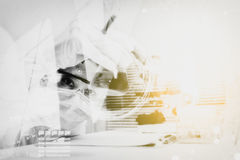 Double exposure of scientist are certain activities on experimen Stock Photography