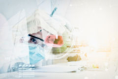 Double exposure of scientist are certain activities on experimen Royalty Free Stock Photo