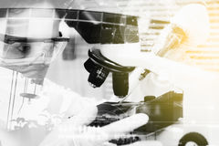 Double exposure of scientist are certain activities on experimen. Tal science like mixing chemicals, use microscope, entry data to development ,copy space, mock Royalty Free Stock Photos