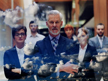 Double exposure of senior business man with his team at office Stock Photos