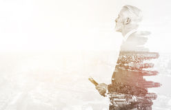 Double exposure of senior businessman Royalty Free Stock Photography