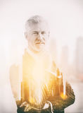 Double exposure of senior businessman Stock Images