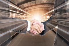 Double exposure of shaking hand business people stock image