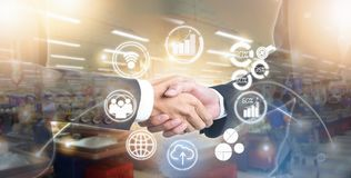Double exposure of shaking hand business people for success deal on marketing online stock photography