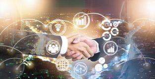 Double exposure of shaking hand business people for success stock photo