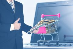Double exposure Shopping cart or supermarket trolley with laptop. Notebook on white background and copy space, e-commerce and online shopping concept Stock Images