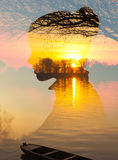 Double exposure - silhouette of girl over landscape showing river and boat Royalty Free Stock Images