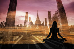 Double exposure of Silhouette yoga woman against Sukothai historical park royalty free stock image