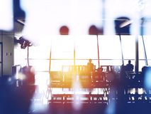 Double exposure with silhouettes of passengers in the airport waiting for boarding. Conceptual image to express business travel by airplanes stock image