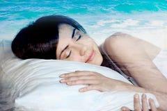 Double exposure  sleeping girl and blue ocean Royalty Free Stock Photos