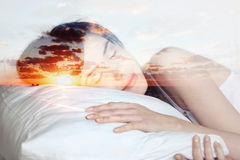 Double exposure  sleeping girl and sunset, dreams Royalty Free Stock Photo