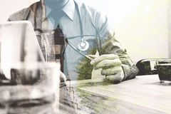 Double exposure of smart medical doctor working with digital tab Stock Image