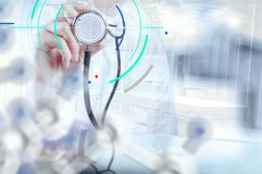 Double exposure of smart medical doctor working with operating r. Accurate diagnosis appropriate treatment medical concept.Doctor hand working with stethoscope stock photos