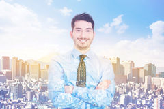 Double exposure of smiling businessman and city Stock Photos