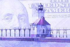 Double exposure St. Joseph north pier lighthouse along shoreline of Lake Michigan with hundred dollar bill background Royalty Free Stock Photos