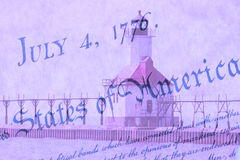 Double exposure St. Joseph north pier lighthouse along shoreline of Lake Michigan with US constitution background Royalty Free Stock Photography