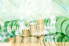 Double exposure of stacks of coins and account book or credit ca Stock Photography