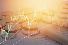 Double exposure of stock exchange graph chart and coins, pen, calculator, saving account passbook Royalty Free Stock Images