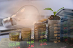 Double exposure stock financial indices with stack coin. Stock Image