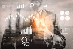 Double exposure of success businessman holding digital tablet co. Financial report data of business operations (balance sheet and income statement and diagram) Stock Image