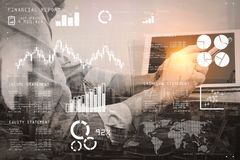 Double exposure of success businessman using smart phone,digital. Financial report data of business operations (balance sheet and income statement and diagram) Royalty Free Stock Image