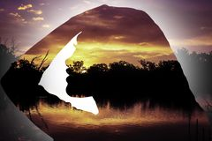 Sunset Silhouette of young girl side profile stock photography