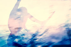Double exposure of a surfer surfing in the ocean. Summer time colors Stock Images