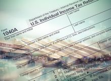 Double exposure tax return with coin and bokeh on light green ba royalty free stock photos