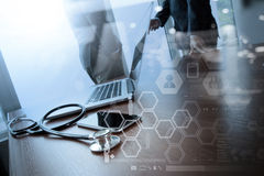 Double exposure of team doctor working with laptop Stock Image