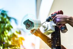 Free Double Exposure Technician Installation CCTV Camera On A Pole , Show Signal , Blurred Background With An Infographics City Buildin Royalty Free Stock Photos - 178969088