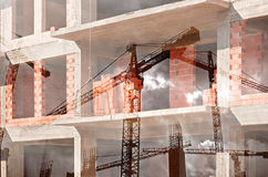 Double exposure of tower cranes and working construction site Royalty Free Stock Photo