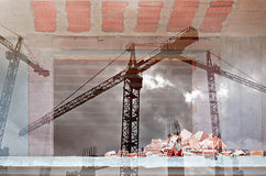Double exposure of tower cranes and working construction site Royalty Free Stock Photos