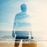 Double exposure of traveler and sea Stock Photos