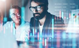 Double exposure.Two stock traiders making analysis of digital market and investment in block chain crypto currency. Stock trade concept stock photos