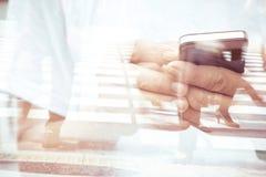 Double exposure of using smart phone Stock Photo