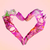 Double exposure of woman hands forming a heart and flowers Royalty Free Stock Images