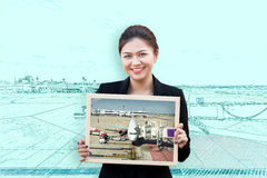 Double exposure of woman holding board with aircraft in runway Royalty Free Stock Photos