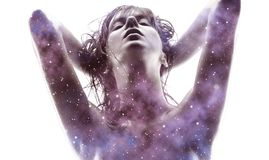Double exposure of woman and purple galaxy royalty free stock photos