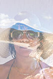 Double exposure of a woman in a sunhat and exotic beach Royalty Free Stock Images