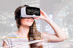 Double exposure. Woman with virtual reality goggles. Night city. Royalty Free Stock Images