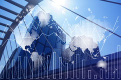 Double exposure of world map and financial graph chart on cityscape background. Double exposure of cityscape and financial graph chart, network and world map on royalty free stock photos