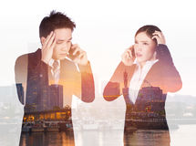 Double exposure of worried businessman and businesswoman talking Royalty Free Stock Images